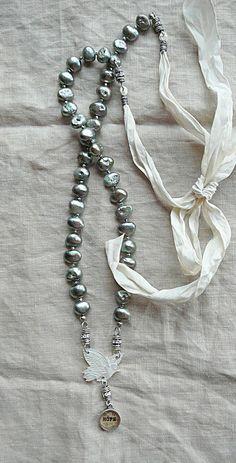 Nina Bagley, pearls and silk.  Love this.