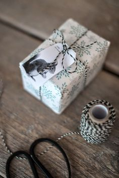 Fairy Nuf: christmas. Love paper, squirrel tag & butchers twine