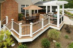 Decks.com. White posts, contrasting rail, black pickets, trim edge