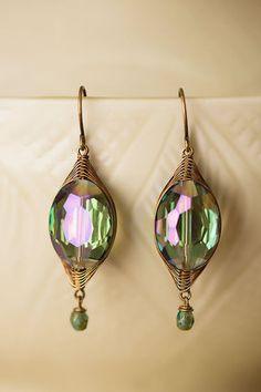 Handmade faceted crystal dangle earrings are featured on our herringbone weave