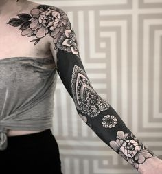 These Striking Solid Black Tattoos Will Make You Want To Go All In - beautiful floral and mandala patterns on a solid black sleeve © tattoo artist Jack Peppiette - Tattoo Sleeve Cover Up, Black Sleeve Tattoo, Black Tattoo Cover Up, Cover Up Tattoos, Arm Tattoos, Life Tattoos, Flower Tattoos, Body Art Tattoos, Black And Grey Tattoos Sleeve