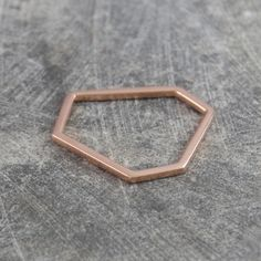 Hexagon Geometric Contemporary Rose Gold Ring - Wonderfully chic, these Hexagon Geometric Contemporary Rose Gold Rings look great worn alone or stacked together for an on-trend mixed metal look. An ideal rose gold stacking ring! #Otisjaxon #Jewellery