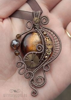 October 12, 2010 in jewellery, pendant | Tags: brass, brown, crafts, czech fire polished glass, enamelled copper wire, gold, handmade, jewellery, jewelry, Octocon, silver foil glass, steampunk, venetian glass, victorian, watch parts, wire, wire wrapping.