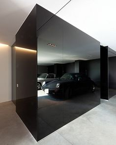 Great black mirror wall. Find more ideas on our blog.http://yam.st/y7t8 #contemporaryinteriors #garage