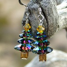 The handmade Sparkling Christmas Trees earrings were created with four sizes of medium vitrail Swarovski crystal margarita discs, sunflower yellow Swarovski bicones, light Colorado topaz Swarovski cubes and sterling silver Christmas In July, Christmas Countdown, Christmas Trees, Christmas Shopping, Christmas Crafts, Christmas Ornaments, Christmas Jewelry, Handmade Christmas, Christmas Tree Earrings