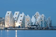 Built by CEBRA,JDS,SeARCH,Louis Paillard Architects in Aarhus, Denmark with date Images by Mikkel Frost. The Iceberg is located at a prime location on the outmost harbour front in Aarhus' new quarter Aarhus Ø (Aarhus East). Aarhus, Art Et Architecture, Amazing Architecture, Contemporary Architecture, Futuristic Architecture, Danish Apartment, Amazing Buildings, City Buildings, Building Design
