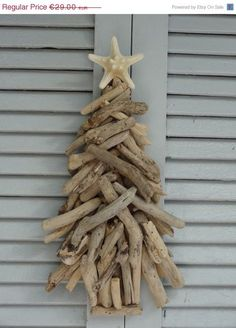 """""""How about a cute driftwood pumpkin? I know it usually calls for Fall decor, but I can imagine this driftwood decor anytime in our living room. Little rock shaped driftwoods are perfect for this project and glue them on Styrofoam ball or ornament. Driftwood Christmas Tree, Beach Christmas, Natural Christmas, Coastal Christmas, Christmas Holidays, Christmas Crafts, Christmas Decorations, Xmas, Driftwood Projects"""