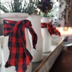 "NEW on the site! From the designer: ""Farmhouse Christmas jars are made using glass milk bottles from Dollar Tree, a little bit of craft paint, and buffalo check ribbon. This project costs less than $3 to make for one jar."""