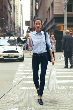 Lucy Yang. Classic blue button down, dark skinny jeans, and knock-around kicks.