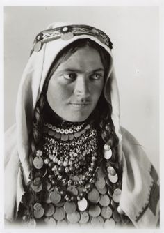 Shoulder portrait of a woman with headgear and necklace, © The National Museum of Bosnia and Herzegovina * Headdress from Drvar*
