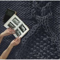 Knitted carpet designed by Christien Meindertsma