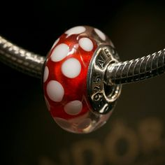 """!Sale! Pandora Minnie's Signature Disney charm Pandora """"Minnie's Signature"""" glass charm, NWOT.  Properly hallmarked S925 ALE.  In stock and ready to ship!  Bracelet not included.  Pandora box not available.  No trades please.  Thanks and check out my closet for more great items! Pandora Jewelry Bracelets"""
