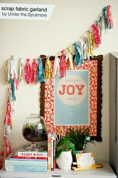 diy {scrap fabric garland} » ashleyannphotography.com  I love the way she knotted them!  Get ready living room..