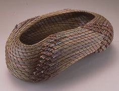 An abstract sculptural basket by Peggy Wyman, pineneedles