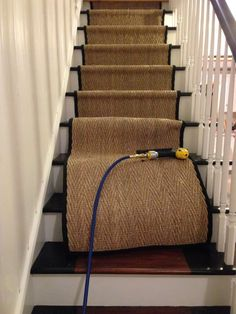 installing seagrass safavieh stair runner - for the basement stairs Staircase Runner, Modern Staircase, Staircase Design, Sisal Stair Runner, Spiral Staircases, Carpet Runners For Stairs, Stairs With Carpet, Stair Carpet Runner, Striped Carpet Stairs