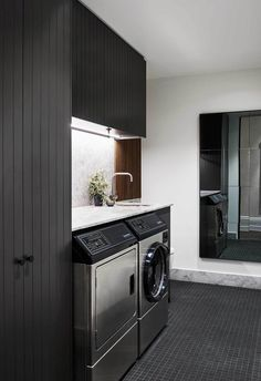 black flooring Washing zone: The laundry space sits beside the stairwell with a dark colour palette echoing that used in the kitchen. Black cabinetry adds dramatic effect against the black floor tiles. Modern Laundry Rooms, Laundry In Bathroom, Laundry Cupboard, Basement Laundry, Decor Interior Design, Interior Decorating, Decorating Games, Interior Ideas, Laundry Room Inspiration