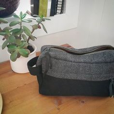 Weekend slow sewing: I finished this dapper monochrome wool dopp kit, from the @grainlinestudio #portsidetravelset. I still despise setting in the bottom, but I played around with a more integrated way of attaching the lining, and that was fun. Lucky dad who gets his birthday presents spread out over six months!  The duffle bag is next and last. #nextprojectisselfishsewingnextprojectisselfishsewing,portsidetravelsetindigorchid