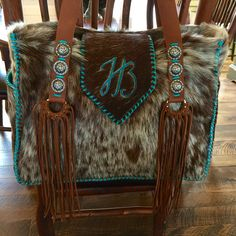 A Buckaroo Diaper Tote with the owner's initials, pecan suede fringe and laced in turquoise leather lace. gowestdesigns.us