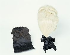 Man's wig and wig bag. For over a century from the 1660s to the late eighteenth century, fashionable men chose to shave their natural hair and to wear a wig instead. To make up their wigs, perukiers used different hairs, including horse or goat, or for the most costly wigs, human hair. This very rare survival is made of white horsehair and was worn by Thomas Carill-Worsley who lived at Platt Hall from the 1760s.