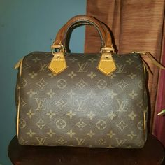 Louis Vuitton Speedy 25 Louis Vuitton Speedy 25. Handles have darkened and have very superficial cracks here and there and the inside has a pen mark. No cracking in the canvas, no exposed piping and no damage other then above mentioned. Will trade for Louis Vuitton only!!! TV $700 Bags Satchels