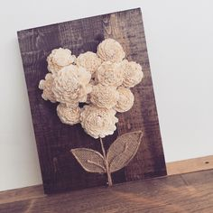 This romantic wood flower sign is handmade just for you! Details: Made from sola wood flowers, burlap, twine, and recycled pallet wood. Dimensions: 16in x 13.
