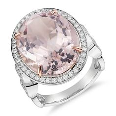 This gemstone and diamond ring features an oval morganite surrounded by brilliant diamonds and complemented in 18k white and rose gold.