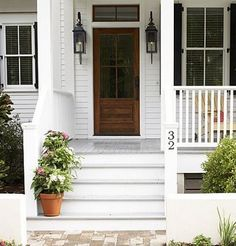 Inviting front porch with beautiful curb appeal  Love the glass front  wooden door  the potted plants on the steps  the grey painted steps and the  lanterns  15 Beautiful Farmhouse Front Doors   Farmhouse front  Front doors  . Exterior Doors Farmhouse Style. Home Design Ideas