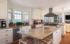 Kitchen with white cabinets and giallo ornamental granite countertops