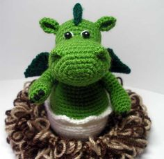 "Pattern available to buy for ""Baby Dragon in its Nest"" by Masha Pogorielova."