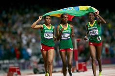 Three Ethiopian runners finish in the top six in women's 3000m steeplechase. Sofia Assefa earns the bronze medal and is joined in celebrating with Hiwot Ayalew (5th) and Etenesh Diro (6th).