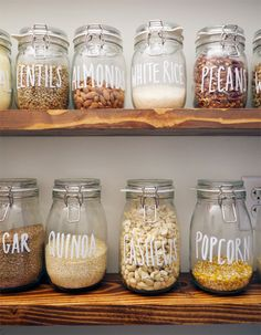 Organize spices, grains and other pantry items in your kitchen with IKEA KORKEN jars and white chalk markers! Click to see the full DIY!
