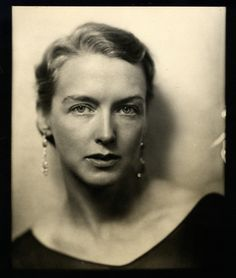 Black and white photograph of a close-up of Mrs. George Hill wearing sparkling earrings, 1926