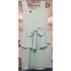 Mint dress Super cute mint dress perfect for any special occasion! Deep V back with bow sexy and cute what more could you ask for!?! Good condition few loose threads. Bow threads came undone in a small area shown in the last pic but easy fix for anyone who can sew. WINDSOR Dresses