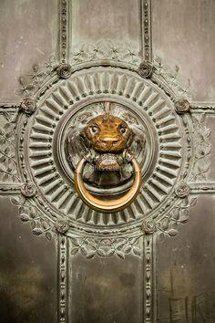 Lion head door pull on entry door of Sacre-Coeur church, Montmartre, Paris, France