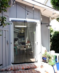 I came up with the perfect solution using VELCRO® Brand Industrial Strength Tape so my screen lays flat, stays perfectly secure and can still be removed! French Doors With Screens, Outdoor Awnings, Diy Screen Door, Home Organization, Diys, Easy Diy, Backyard, Balcony, Outdoor Decor