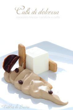 Cubì di dolcezza, un dolce al piatto elegante dove cioccolato bianco, mandorle e caffè danno vita ad un opera unica riprodotta in multipli, quasi una dedica