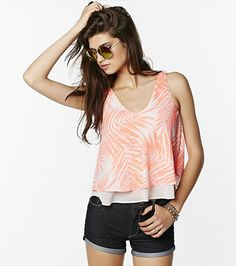 Play it cool in this flowy coral palm tree cropped tank!