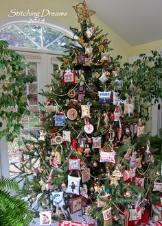 Stitching Dreams - Tree filled with stitched ornaments