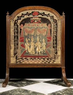 An oak framed firescreen in the Baroque manner. The 18th century tapestry panel depicts Eastern Royal Couple attended by two Pages, with a marquee in the background. Photo before restoration. English, 18th and 19th century, similar to one in the Drawing room in Newhailes House, Scotland.
