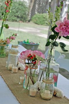 Salvaged jars, liquor bottles, and mason jars make great vases and candle holders.  Burlap makes a great runner too!