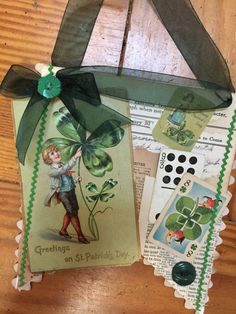 This is a single banner I decorated for St Patricks day. I embellished it with an old postcard and game card as well as buttons and bow.