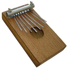 Franklin Phonetic School - Wooden thumb piano.  http://woodworkingteachers.com/default.aspx?g=postst=1942p=2 Look through all 3 pages of projects.