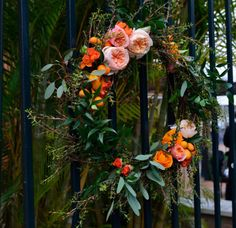 JF Floral Couture - green foliage wreath with peach flowers