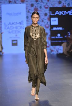 Moss green oversized kurta with green churidaar pants available only at Pernia's Pop Up Shop.