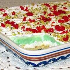 "Pistachio Cream Pie | ""A walnut crust is the perfect stage for a luscious layer of pistachio pudding sandwiched between sweetened cream cheese and a layer of whipped topping. A sprinkling of chopped pistachios and maraschino cherries finish this dreamy pie."""