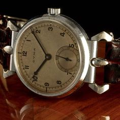 1938 Fantastic Cyma with mobile lugs and 37mm case. Note the gorgeous dial and hands. Cyma was founded in 1862, and is best known for its accurate, ultra-flat movements and cases. During the 1920s, the company was at the forefront of component interchang