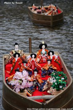 """Hinamatsuri traces its origins to an ancient Japanese custom called hina-nagashi (雛流し, lit. """"doll floating""""), in which straw hina dolls are set afloat on a boat and sent down a river to the sea, supposedly taking troubles or bad spirits with them."""