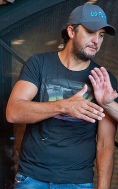 The hair, the scruff, the arm and hand. Lord I'm a dead fangirl