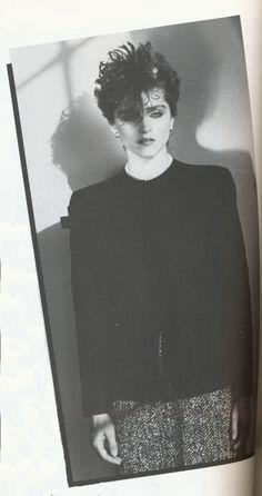 Madonna in an original Adrian black gabardine suit jacket, worn over a 1960's tweed suit skirt. 1982.