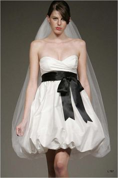 Wedding gowns can be any length you want--especially in Vegas. Go for a shorter hemline and show off those shoes!